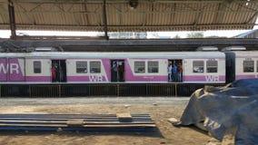 Mumbai suburban train station with passengers stock photo