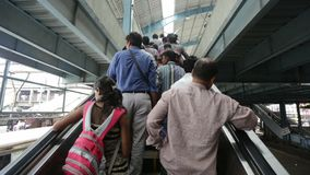 Commuters using the newly started Escalator at Andheri station in Mumbai, India. stock video footage