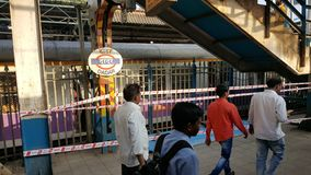 Mumbai local train station with passengers royalty free stock photos