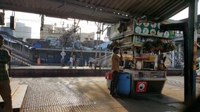 Mumbai local train station with passengers stock images