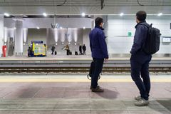 Commuters waiting high speed trains Stock Photo