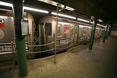 Commuters waiting on train, Times Square st. The NYC Subway is o Royalty Free Stock Photo