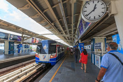 Commuters walk in BTS elevated rails. Bangkok, Thailand - July 23, 2015: Commuters walk in BTS elevated rails, It's the first electric train system in Thailand Stock Photo