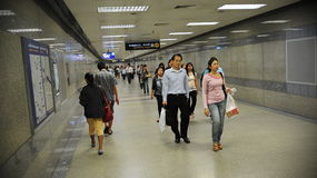 Commuters Walk through Underground Train Station Stock Photos