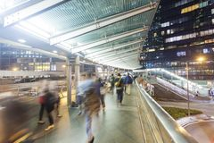 Commuters walking along an elevated walkway Stock Image