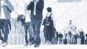 Commuters walking. Commuters arrive at Fiera di Milano, Italy. FieraMilano is one of the area hosting EXPO 2015 stock video