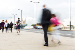 Commuters walking in the city Stock Photos