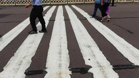 Commuters walking on footbridge stock footage