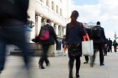 Commuters walking on the London Bridge in London, UK Stock Image