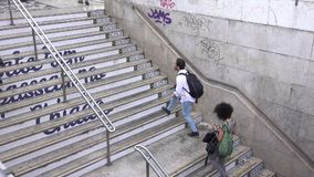 Commuters walking up stairs. Typical scene for visitors to Lisbon Portugal stock video footage