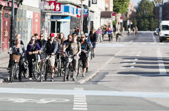 Commuting on bicycle in Copenhagen. Stock Photo