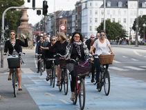 Commuting on bicycle in Copenhagen. Stock Photos