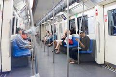 Commuting passengers aboard Bangkok's MRT rail system. Stock Photos