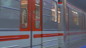 Commuting by subway train, Prague. Underground train arriving to the station and unidentified people getting in. Commuting by subway. Prague, Czech Republic stock footage