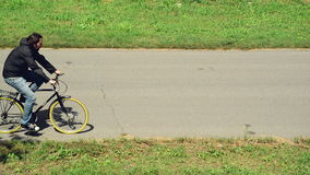 Commuting to work on a bicycle. Man riding bicycle on a bike path marked stock footage