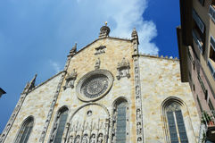 Como Cathedral, cattedrale di Santa Maria Assunta, church facade. With rose window, Gothic cathedral with rococo cupola and a portal between two statues of Royalty Free Stock Images