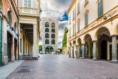 Como city, historic center, lake Como, northern Italy. Medieval tower 12th century, called Porta Torre and via Cantù
