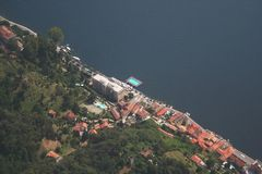 Como lake. A building just over the coastline of Como lake. Note the pool positioned in the lake Stock Photo