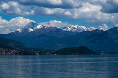 Como. Lake Como in Italy beautiful scenery surrounded by snow capped mountains and lush Forrest Royalty Free Stock Photo