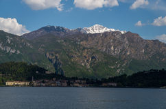 Como. Lake Como in Italy beautiful scenery surrounded by snow capped mountains and lush Forrest Stock Images