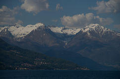 Como. Lake Como in Italy beautiful scenery surrounded by snow capped mountains and lush Forrest Stock Image