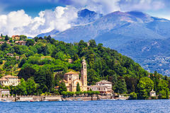 Como lake, Italy. View of houses and hotels on the coast of Como lake, Italy Royalty Free Stock Photo