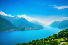Como Lake landscape. Lake, alps and village view, Italy royalty free stock images
