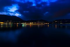 Long exposure of Como lake, Lombardia, Italia, Beautiful lights effect on water. Purple sky. Como Lake, Lombardia, Italy. Picture made during last hours of stock photo