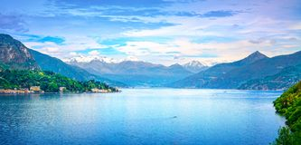 Como Lake landscape. Lake, alps and Tremezzo village view, Italy. Como Lake panoramic landscape. Lake, Alps and Tremezzo village view from Bellagio road. Italy Royalty Free Stock Photo