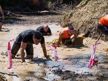 Como Pontes - atletas da Espanha na lama durante a raça 2018 de Xtreme do samurai fotos de stock