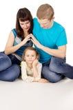 Comodidad y protección del niño contra los padres Foto de archivo libre de regalías