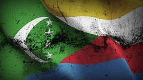 Comoros grunge dirty flag waving on wind. Comorian background fullscreen grease flag blowing on wind. Realistic filth fabric texture on windy day Royalty Free Stock Images