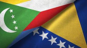 Comoros, Bo?nia i Herzegovina dwa flagi tekstylny p??tno, tkaniny tekstura obrazy stock