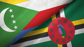 Comoros and Dominica two flags textile cloth, fabric texture. Comoros and Dominica two folded flags together royalty free stock photos