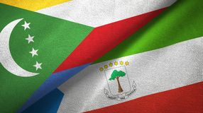 Comoros and Equatorial Guinea two flags textile cloth, fabric texture. Comoros and Equatorial Guinea two folded flags together stock photography