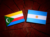 Comoros flag with Argentinian flag on a tree stump isolated Stock Image