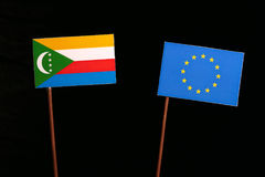 Comoros flag with European Union EU flag isolated on black. Background Stock Image