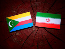 Comoros flag with Iranian flag on a tree stump isolated Royalty Free Stock Image