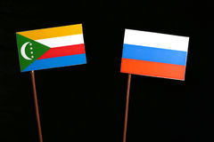 Comoros flag with Russian flag isolated on black Stock Image
