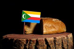Comoros flag on a stump with bread. Isolated Stock Images