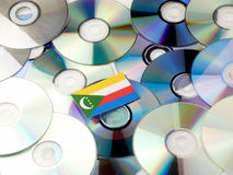 Comoros flag on top of CD and DVD pile isolated on white. Comoros flag on top of CD and DVD pile isolated Royalty Free Stock Photos