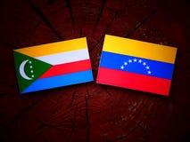 Comoros. Flag with Venezuelan flag on a tree stump Royalty Free Stock Image