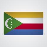 Comoros flagga på en grå bakgrund också vektor för coreldrawillustration vektor illustrationer