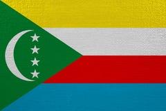 Comoros flagga på kanfas vektor illustrationer