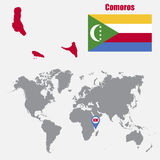 Comoros map on a world map with flag and map pointer Stock Image