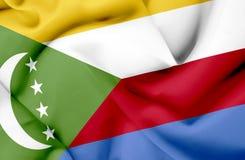 Comoros som vinkar flaggan stock illustrationer