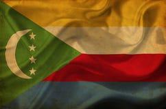 Comoros som vinkar flaggan vektor illustrationer