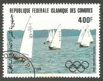Summer Olympics, Finn. Comoros - stamp printed 1983, Multicolor Air Mail Edition of offset printing with Topic Sport and Olympic Games, Series Sailing at Los Royalty Free Stock Images