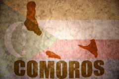 Comoros vintage map. Comoros map on a vintage comoros flag background Stock Image