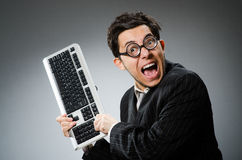 Comouter geek with computer Royalty Free Stock Image